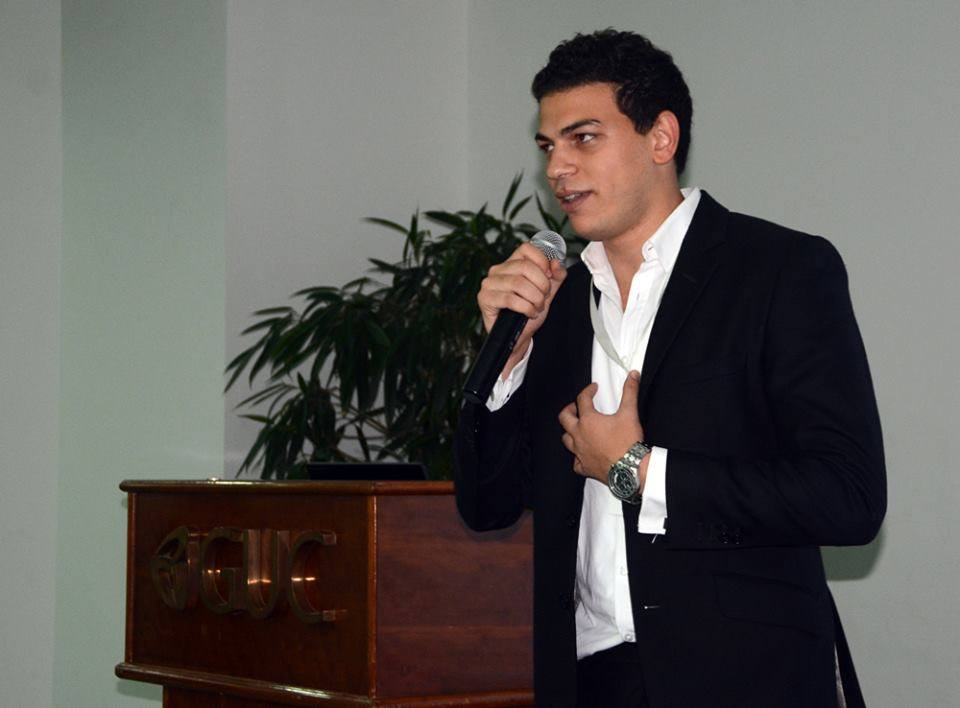 Amr delivering speech at final event of Hult Prize at GUC