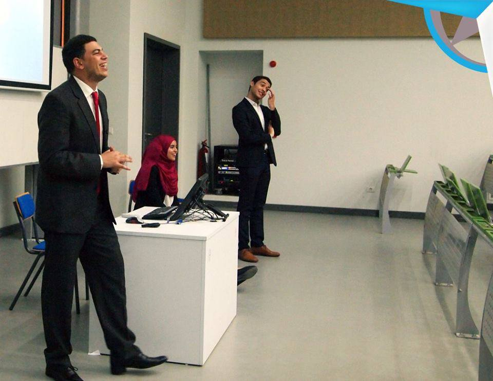 Amr delivering an info session about Bosla Consultancy to students at GUC
